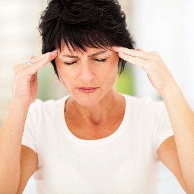 Dentist Highlands Ranch - woman with headache who needs TMJ treatment