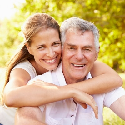 Image of a couple showing the benefits of restorative dentistry